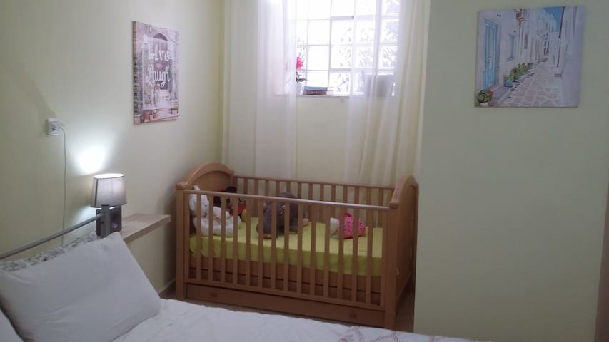 Bedroom with double bed, single bed and baby bed