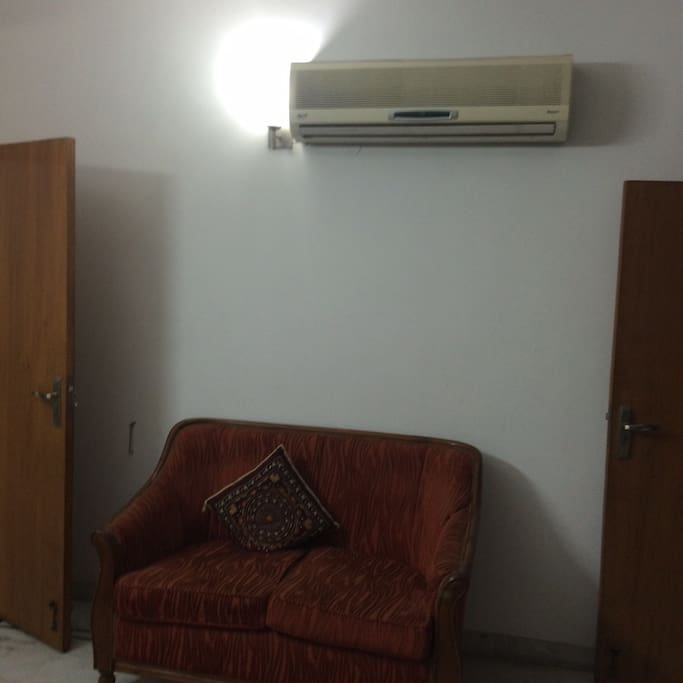 Split AC and sofa.