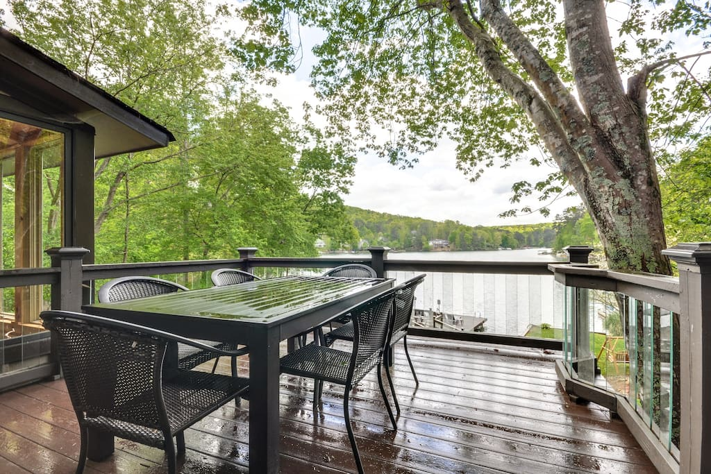 Large Deck with glass balusters and resin deck.  Grill and seating for 8.