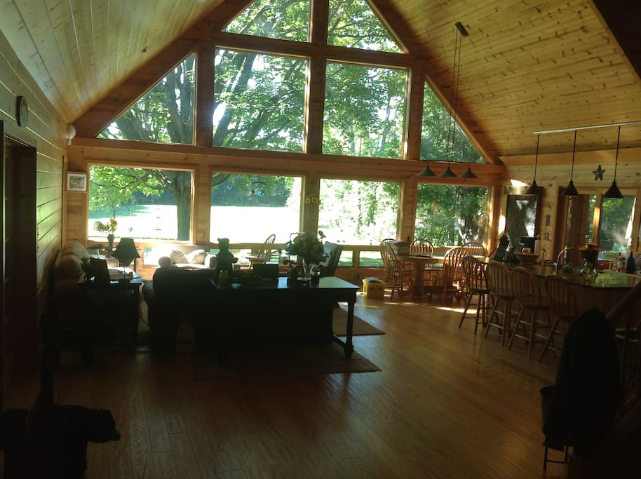 Great room & dining room with view over looking pond and field.
