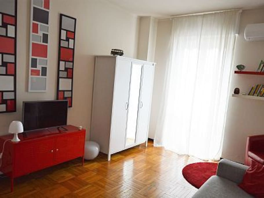 TV set, air conditioning and practical closet with mirror.