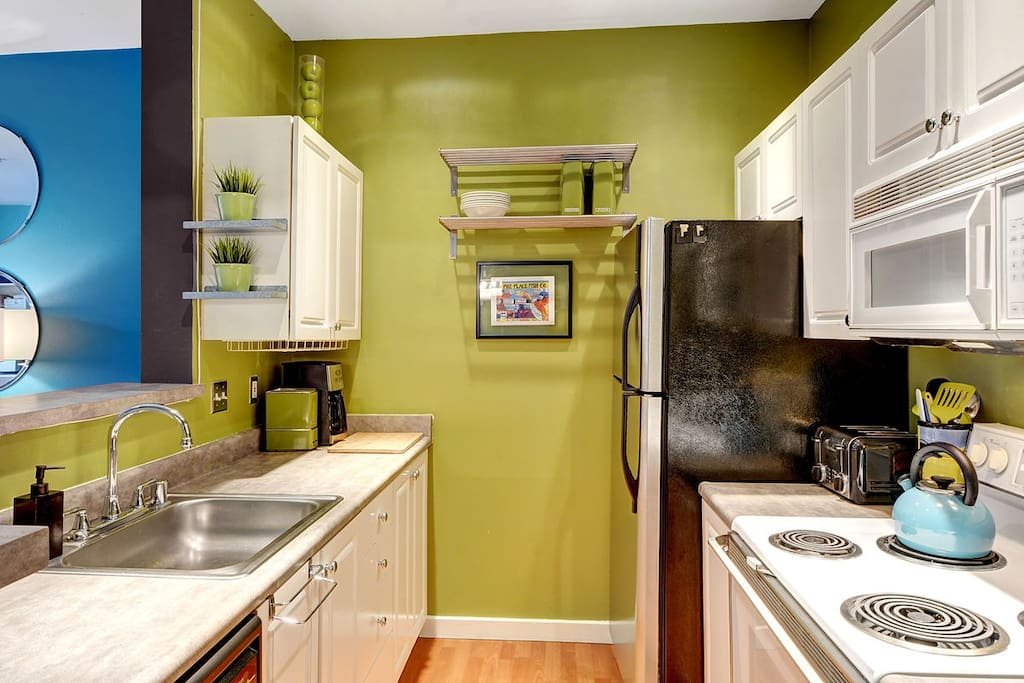 Fully stocked kitchen awaits your chef's touch!