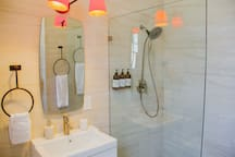 The bathroom is modern and clean with a large walk-in shower.