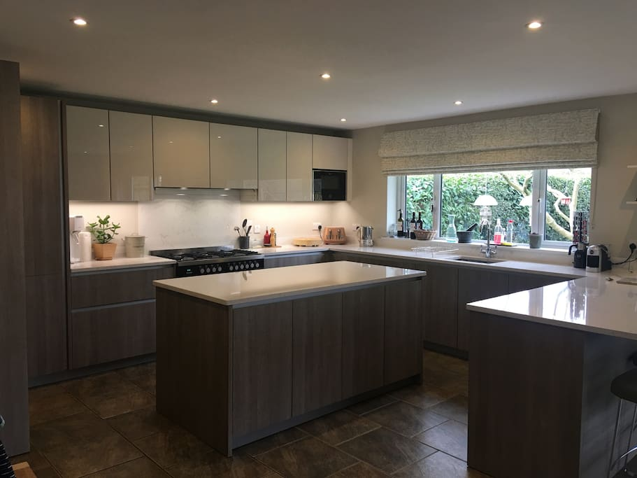 Newly fitted kithen with all built in appliance and large 6 ring range gas cooker, and breakfast bar.