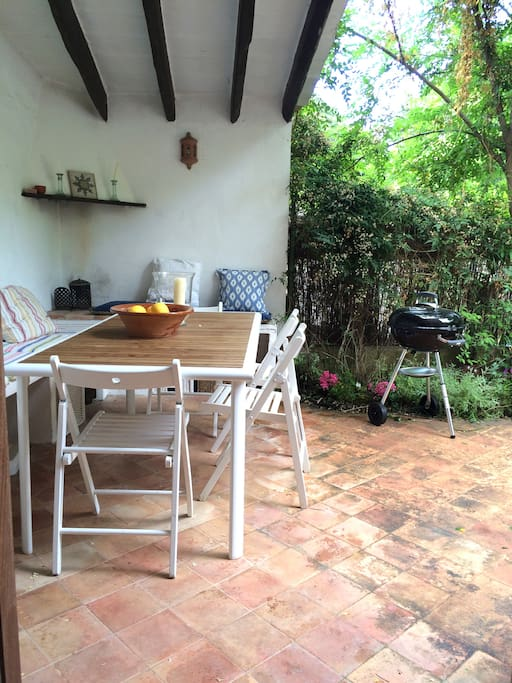 Partly covered patio terrace with BBQ and views of Deia puig.