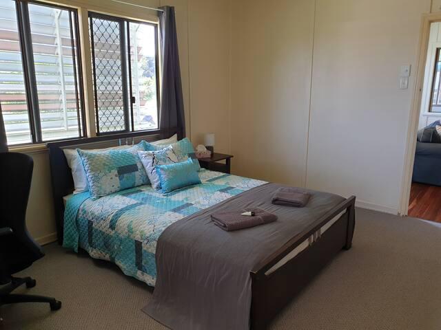 Queen bedroom with desk