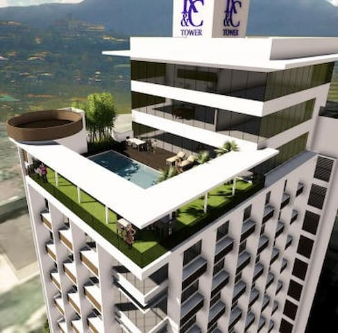 Condo Unit (5K) Balcony, Wifi, Walk to AYALA MALL