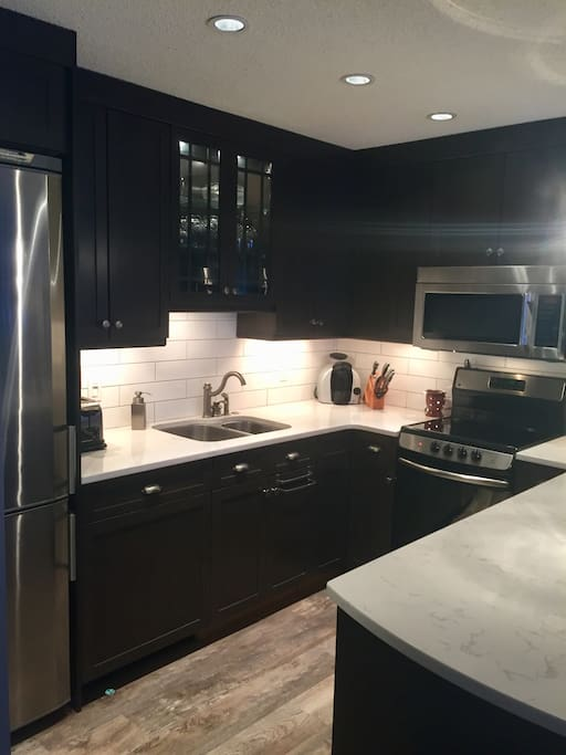 Newly renovated kitchen. Custom cabinets, quartz countertops, stainless appliances, eat up island, Miele silent dishwasher and fully equipped for every type of cook.
