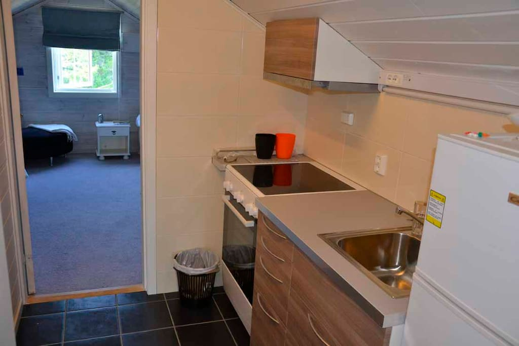 Small Kitchen besides blue and red room