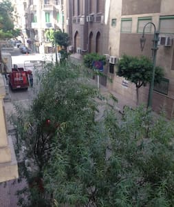 Bedroom with a balcony in Downtown - Cairo - Apartment