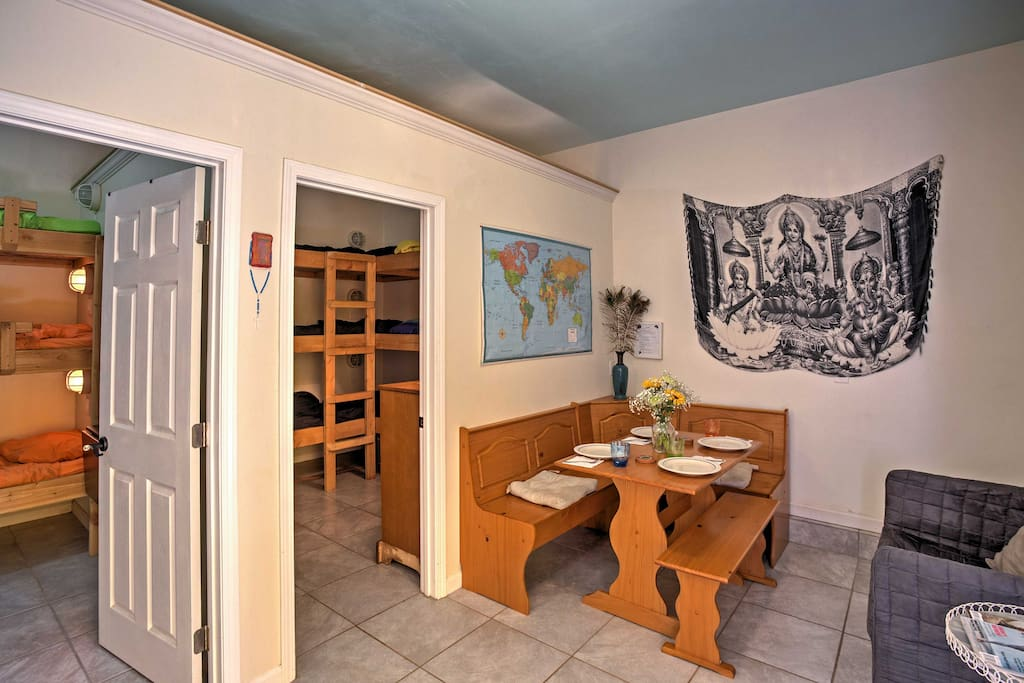 The cozy living space boasts a table with seating for 4 guests.