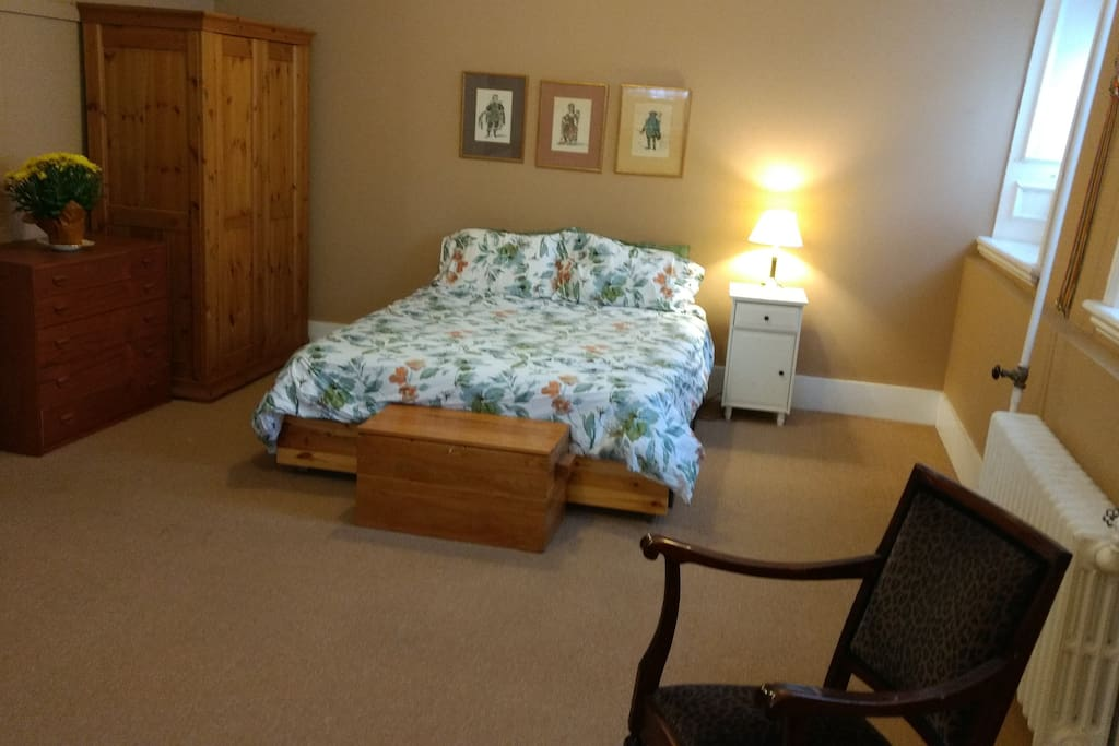 The sleeping area has a queen sized bed and plenty of storage.