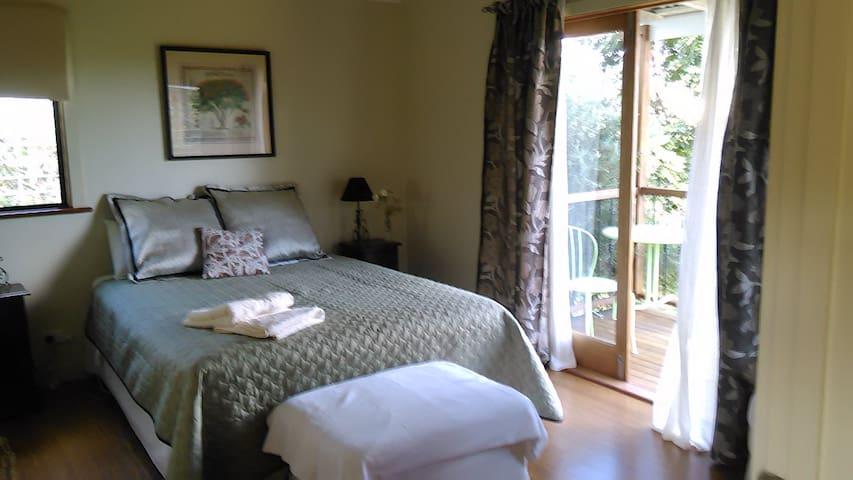 Poinciana room, queen bed, en suite and balcony