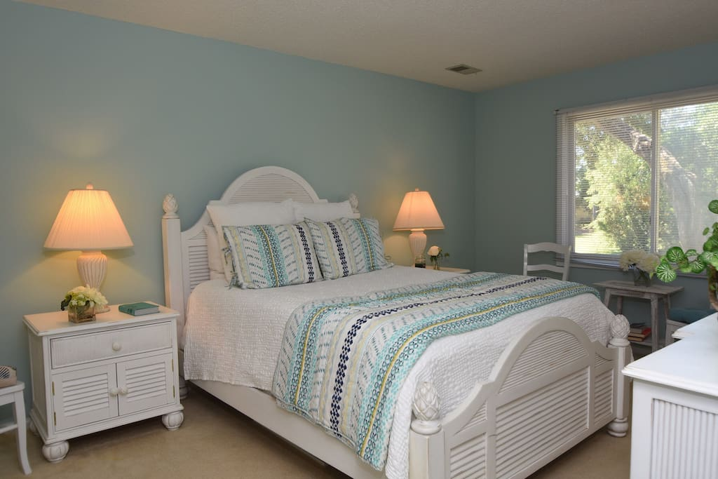 Master bedroom with super comfy queen sized bed.  Bedroom opens to deck.  Attached full bathroom.