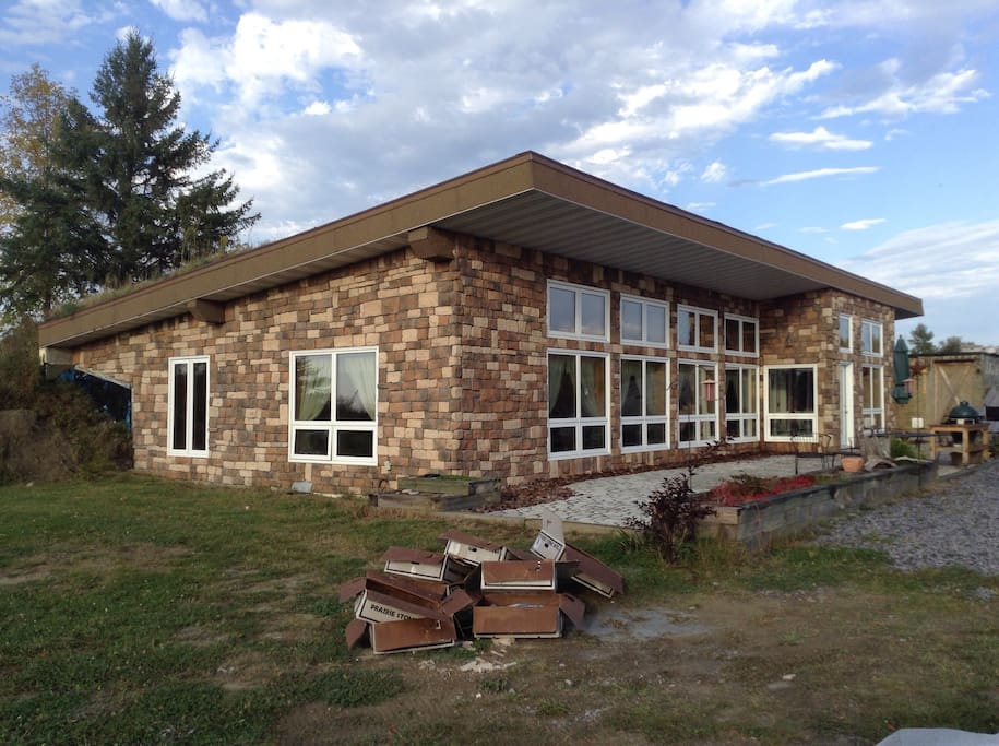 The stone finish went on the house in August 2015.   We have more landscaping planned for the summer of 2016.