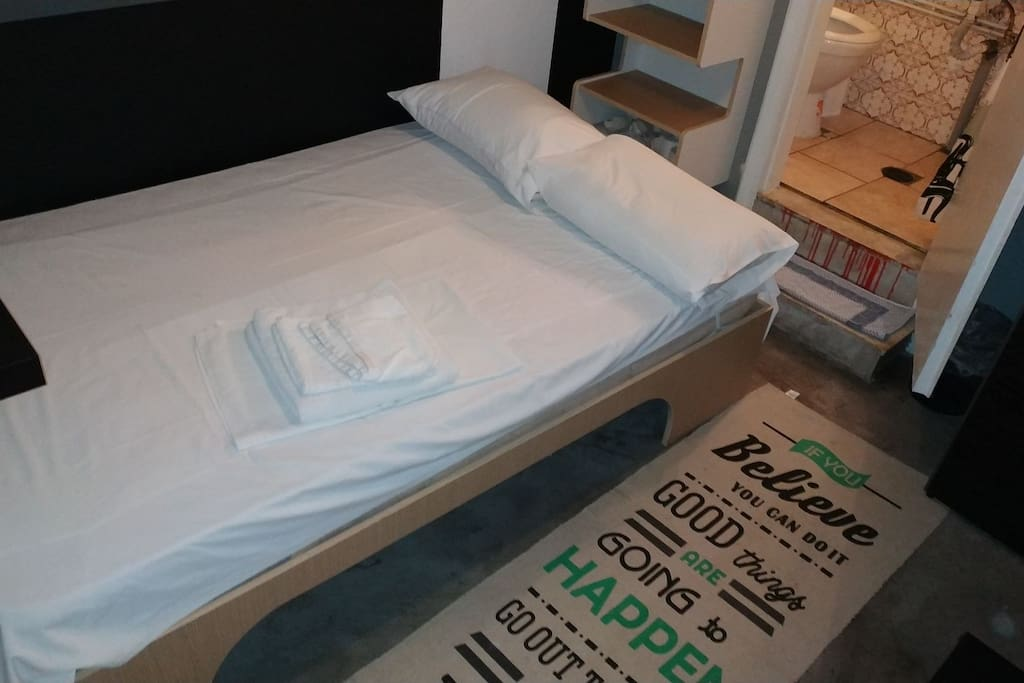 Inside of the studio . New bed