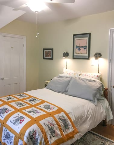 Antique full-size bed frame with 3 pillows person of varying densities. For the read-in-bed visitor... 2 wall sconces. New ceiling fan and overhead light.