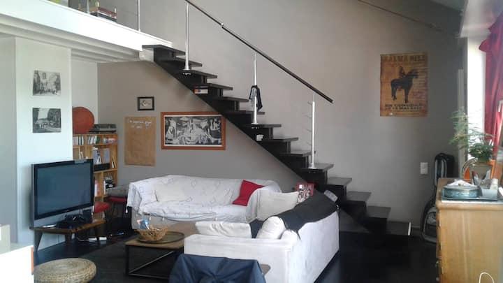 Grande chambre dans un loft d'architecte
