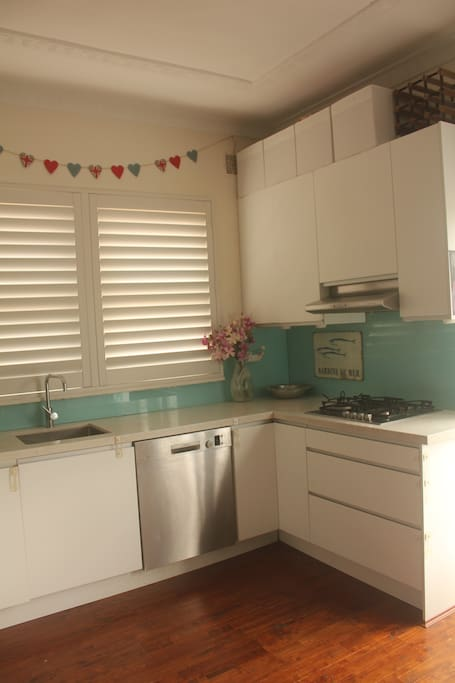 Recently renovated kitchen with gas hob, electric oven, microwave, dishwasher, kettle and all things you need for cooking meals and more!