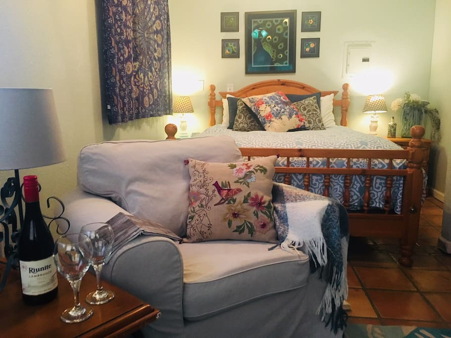 Spacious master bedroom, Queen bed. Looks out toward guests' private chicken barn and garden.