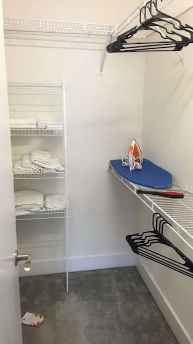 Walk-in closet with extra sheets, towels, wash cloths etc.