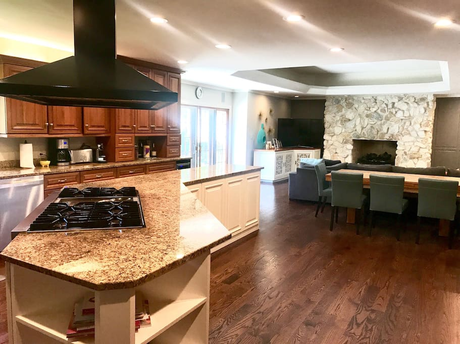 Chef's kitchen with Subzero fridge, double oven, and 6-burner commercial stove with griddle