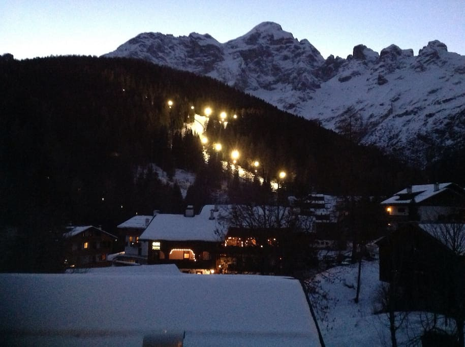 view of night skiing from balcony