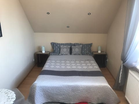 Double bedroom w. balcony, attic, kitchen, toilet
