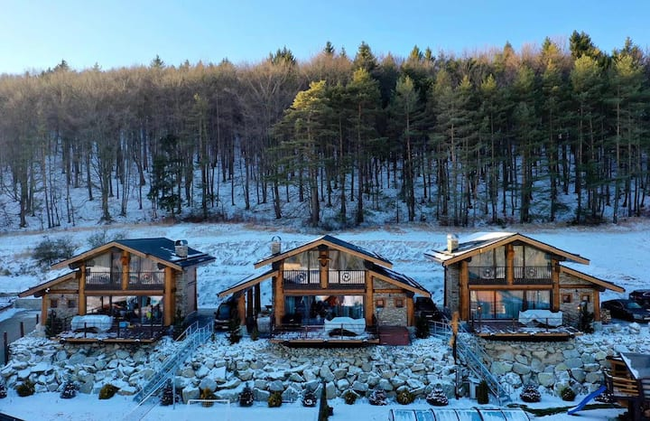 Mountain chalets snowland Valcianska dolina