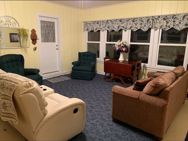 Breezeway/living room is on the ground level and is the entrance to the house, has a hide-a-Bed