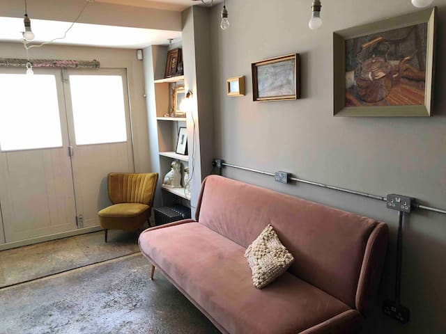 This is the extra room downstairs that can be used as a quiet space or a 4th bedroom. This is on the ground floor off the dining area. There is ample storage and also the laundry facility is in the cupboard in this room.