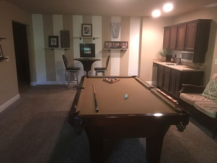 Pool table and pub table and chairs