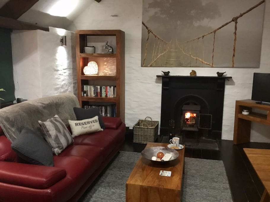 Lounge with wood burner, freeview TV,  books, board games and dvd's.