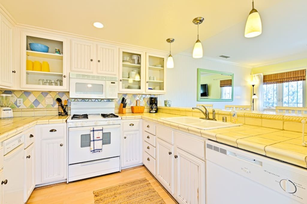 Bright, cheery fully equipped Kitchen to meet all of your culinary needs.