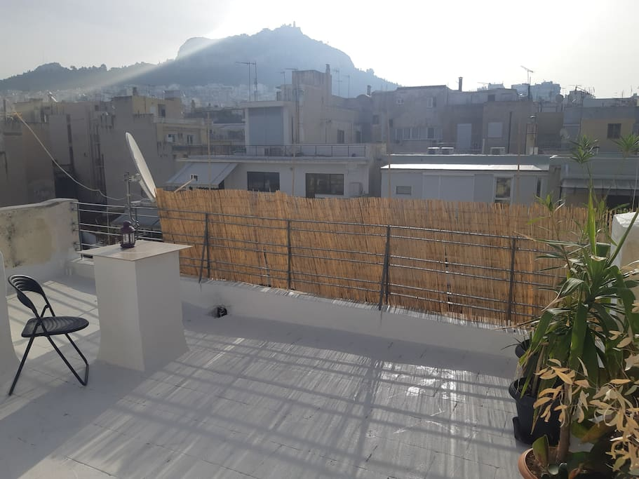 Open views over all of Athens! Your own balcony and beautiful rooftop garden