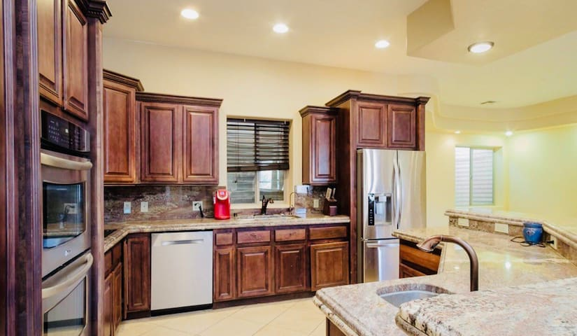 KITCHEN - Full kitchen with large island with bar seating for 6, double ovens, microwave, coffee maker etc.  Table with bench seating to allow for up to 10 to eat at a time.