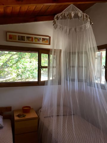 Bedroom 2 - The single bed with a mosquito net