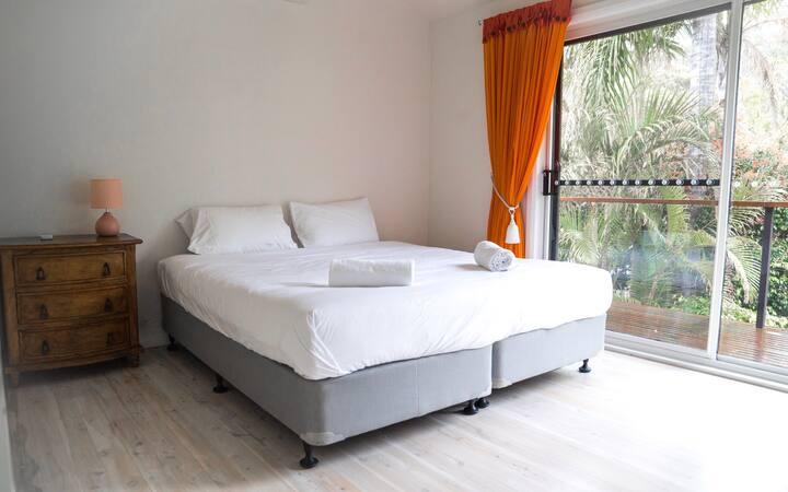 Bedroom in Cromer tropical feel overlooking pool