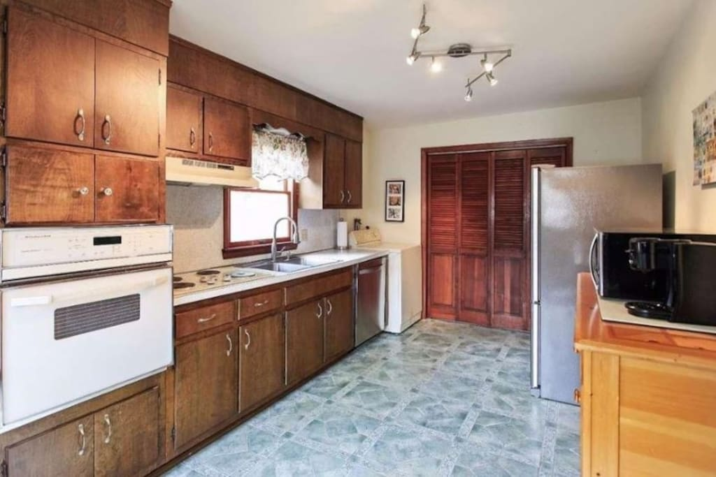 Large kitchen with on premise laundry