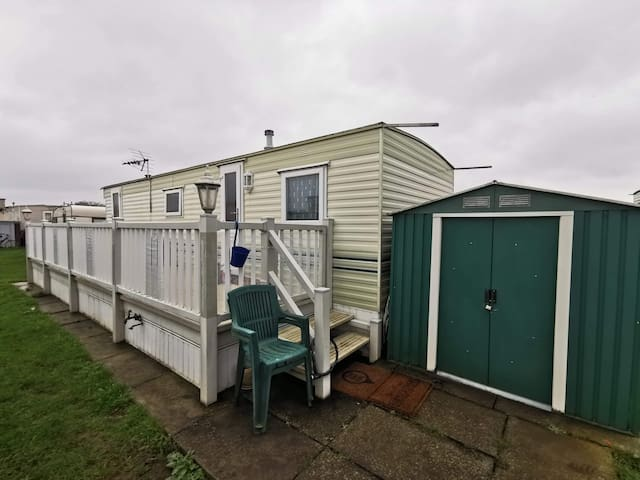 Short ferry caravan with fishing lakes and pool