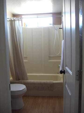 Private bathroom with soap, shampoo, and towels provided.