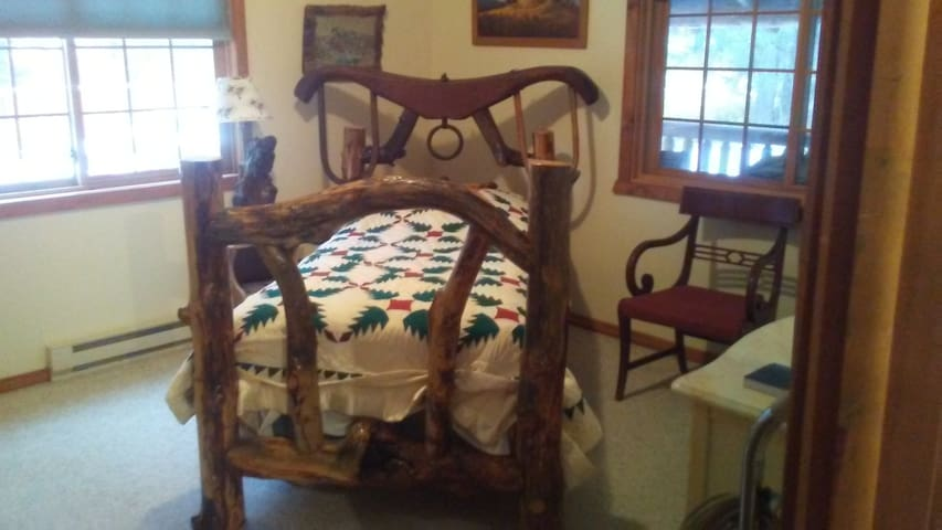 Abigails Room . Single log bed with a Cowgirl kind of influence..