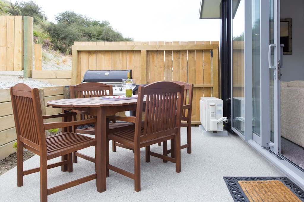 Private outside area with gas BBQ and table and chairs