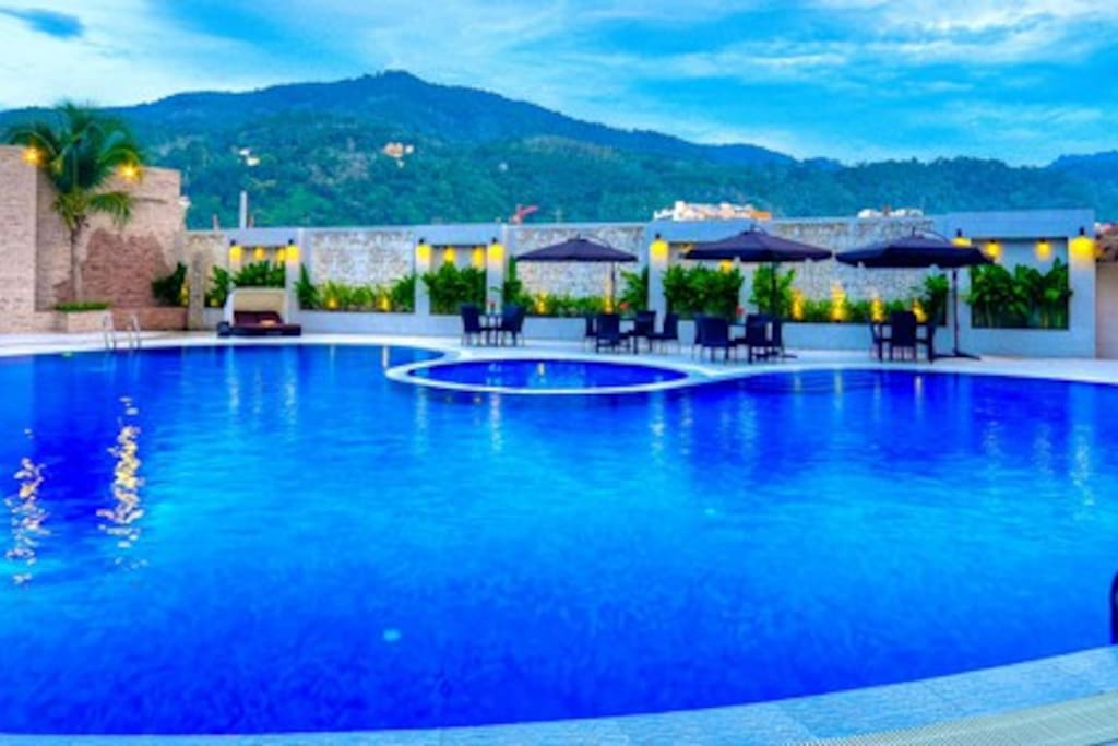 Main swimming pool with mountain view.
