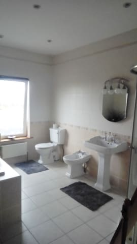 Main bathroom for sole use by occupants of this room during their stay.