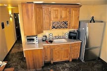 Kitchenette with full-size fridge/freezer with ice. Microwave, Toaster oven, electric kettle and bottled water on tap.