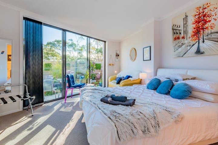 Queen size bed, double doors opening on to private garden courtyard with en-suite ..