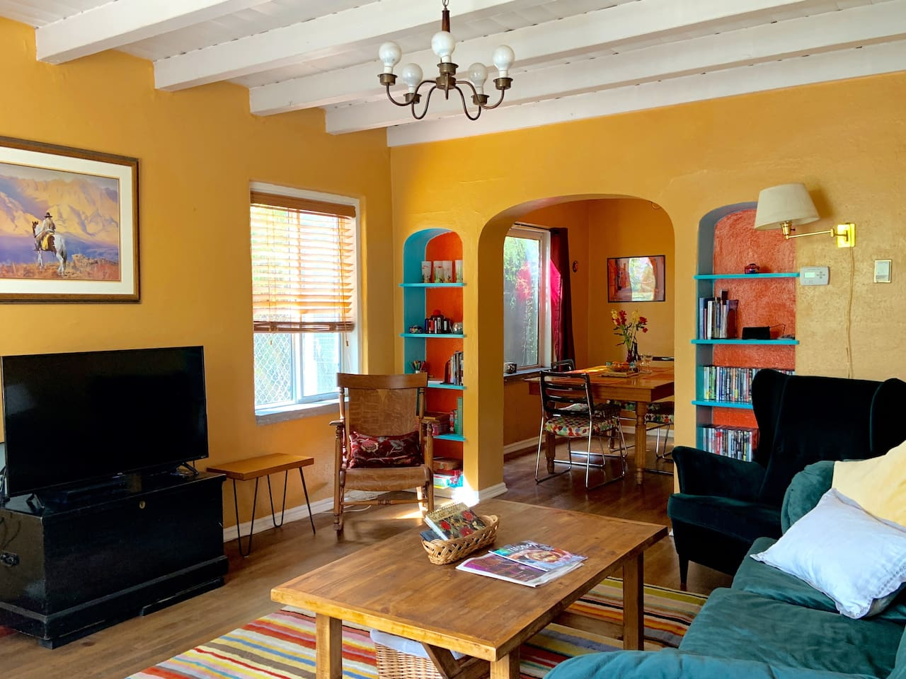 Colorful 1930's Santa-Fe style house with beamed ceilings and original wood floors.