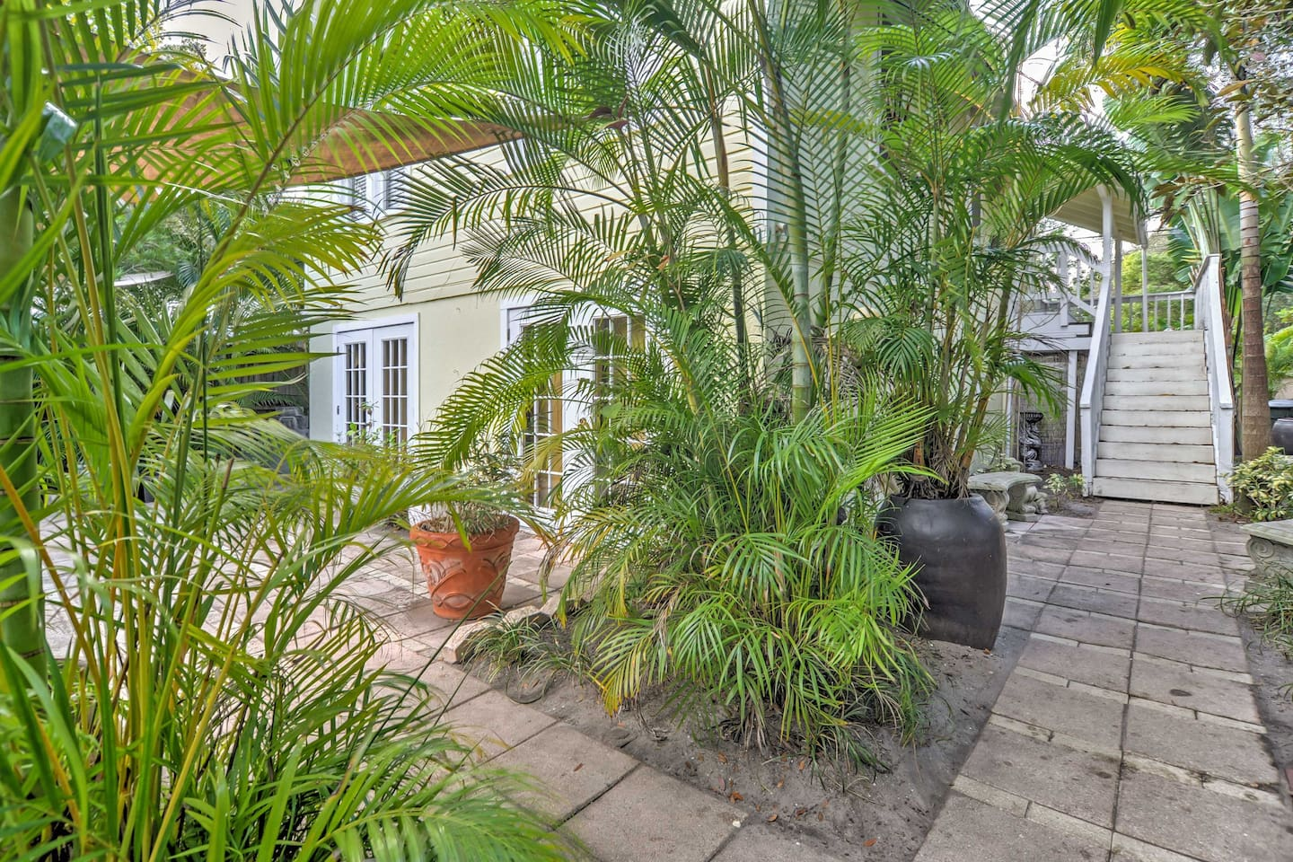 Sit back in tropical gardens and soak in a multi-lighted swim spa while staying at this lovely 2-bedroom, 1-bath vacation rental home in Largo.