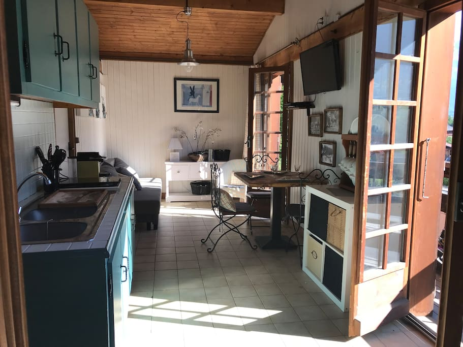 Open plan kitchen dining & living area. Table seats 4. Fridge, mini oven/grill, 2 gas hobs & sink